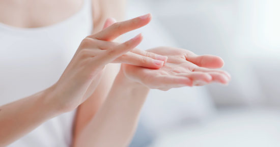 woman apply moisturizer in hand